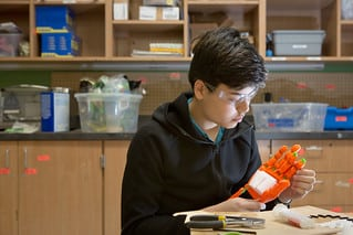An engineering student constructs a robotic hand for a project.  Photo by Allison Shelley/The Verbatim Agency for American Education: Images of Teachers and Students in Action
